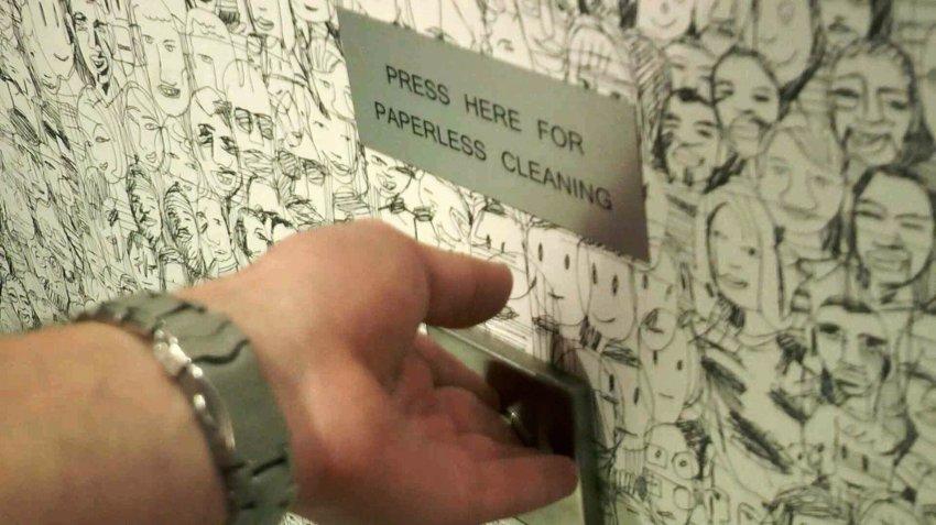 Кнопка в туалете: иллюстрация для статьи об офисе, где сотрудники обходятся без бумаги