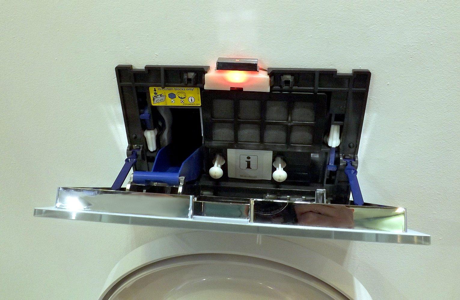 Клавиша Sigma 40 с элементами системы очистки воздуха Geberit DuoFresh в открытом виде
