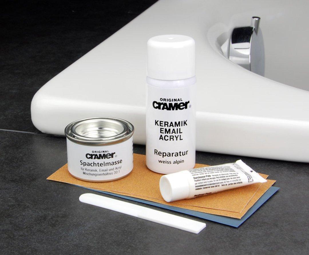 Ремонтный комплект. Иллюстрация к инструкции по восстановлению эмали и ремонте сколов ванны или раковины помощью ремонтного комплекта от Cramer